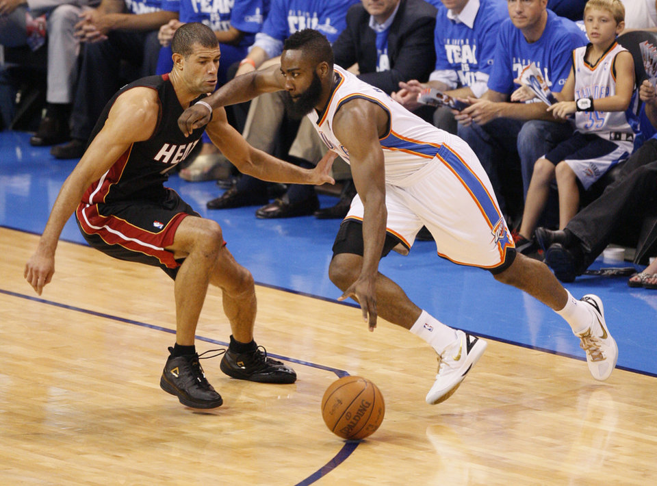 Oklahoma City\'s James Harden (13) tries to get past Miami\'s Shane Battier (31) during Game 2 of the NBA Finals between the Oklahoma City Thunder and the Miami Heat at Chesapeake Energy Arena in Oklahoma City, Thursday, June 14, 2012. Photo by Nate Billings, The Oklahoman