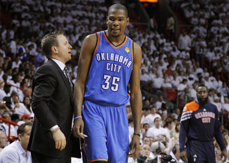 Oklahoma City's Kevin Durant (35) talks with coach Scott Brooks on his way to the bench after picking up his fifth foul during Game 3 of the NBA Finals between the Oklahoma City Thunder and the Miami Heat at American Airlines Arena, Sunday, June 17, 2012. Photo by Bryan Terry, The Oklahoman