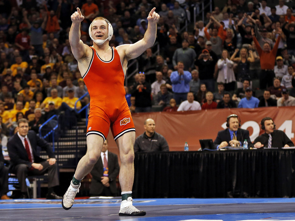 Photo - OSU's Chris Perry celebrates after winning the 174-pound championship match against OU's Andrew Howe in the 2014 NCAA Div. I Wrestling Championships at Chesapeake Energy Arena in Oklahoma City, Saturday, March 22, 2014. Photo by Nate Billings, The Oklahoman