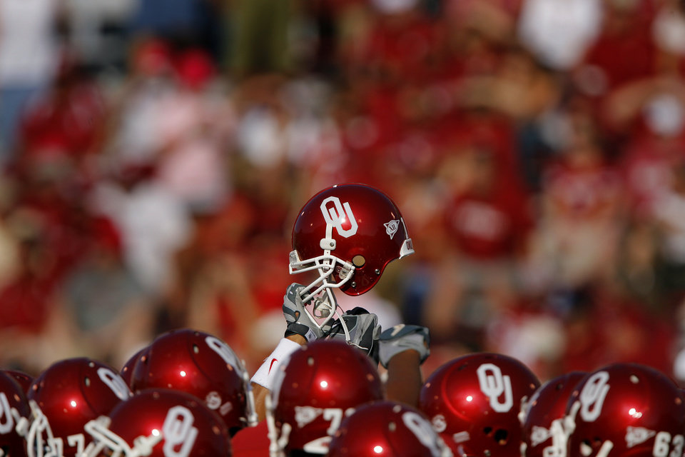 Photo - University of Oklahoma helmets during the University of Oklahoma Sooners (OU) college football game against the University of North Texas Mean Green (UNT) at the Gaylord Family -- Oklahoma Memorial Stadium, on Saturday, Sept. 1, 2007, in Norman, Okla.   By CHRIS LANDSBERGER, The Oklahoman  ORG XMIT: KOD