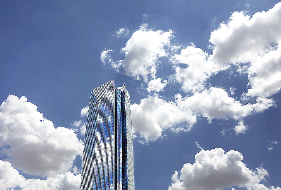 Photo - Fluffy white clouds float over the Devon Energy Tower in downtown Oklahoma City. PHOTO BY JIM BECKEL, THE OKLAHOMAN ARCHIVES  Jim Beckel - THE OKLAHOMAN