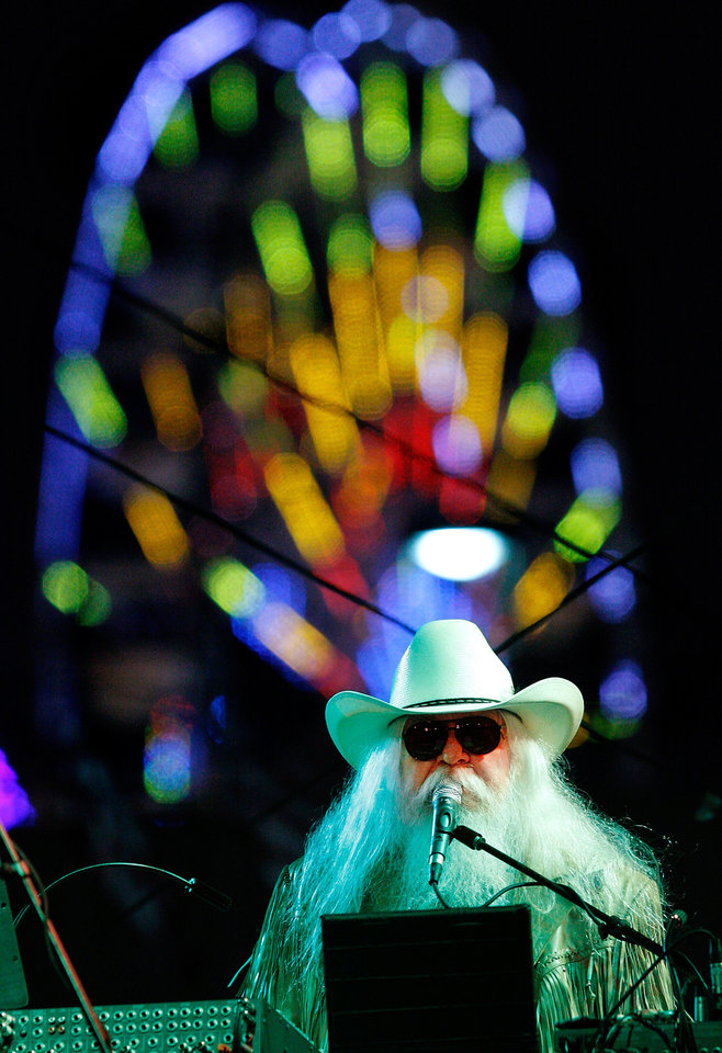 Photo - With the colorful lights of the midway rides as a backdrop, Lawton,  Oklahoma native Leon Russell performed nearly 90 minutes of non-stop hits for an enthusiastic audience at the Chesapeake Energy Stage at the Oklahoma State Fair,   Friday,night, Sep. 16, 2011. The Rock and Roll Hall of Famer's performance is thought to be his first showcase at the fair.   Photo by Jim Beckel, The Oklahoman  ORG XMIT: KOD