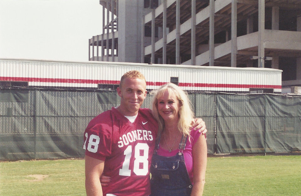Photo - Jason White, left, with his mother Sue White during his time at OU. PHOTO PROVIDED
