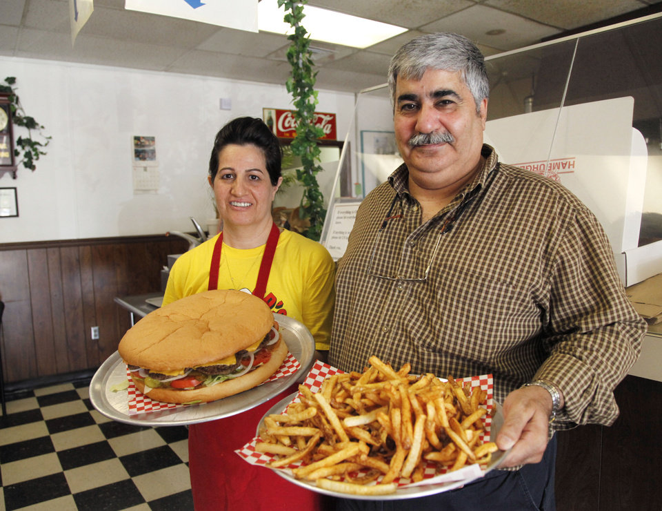 Photo -  Cyrus and Patty Naheed, owners of the last remaining Big Ed's Hamburgers,  still serve 3-pound, family-size hamburgers. Photos by Paul Hellstern, The Oklahoman   PAUL HELLSTERN -  Oklahoman