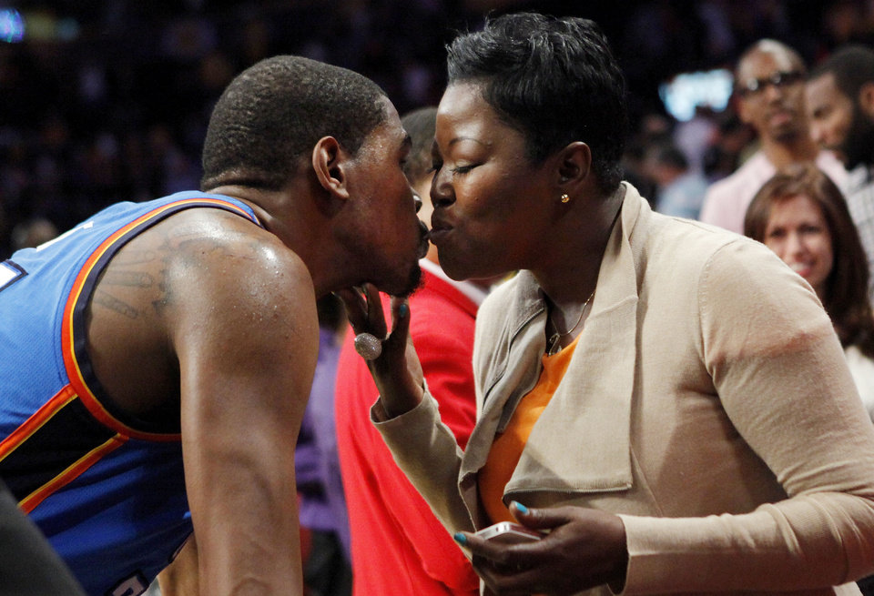 Oklahoma City's Kevin Durant  kisses his mother, Wanda Pratt, after Game 4 in the second round of the NBA basketball playoffs between the L.A. Lakers and the Oklahoma City Thunder in May 2012 at the Staples Center in Los Angeles.  <strong>NATE BILLINGS - NATE BILLINGS</strong>