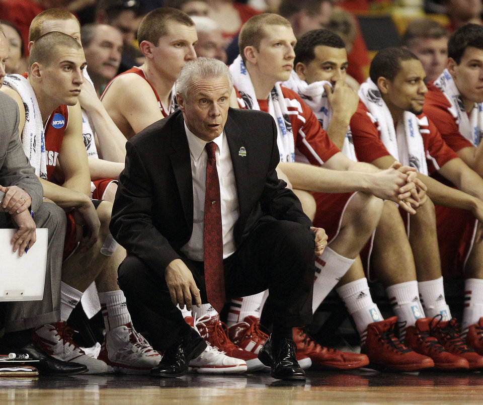 Wisconsin head coach Bo Ryan watches his team against Syracuse in the first half of an East Regional semifinal game in the NCAA men's college basketball tournament, Thursday, March 22, 2012, in Boston. (AP Photo/Michael Dwyer) ORG XMIT: BXG107