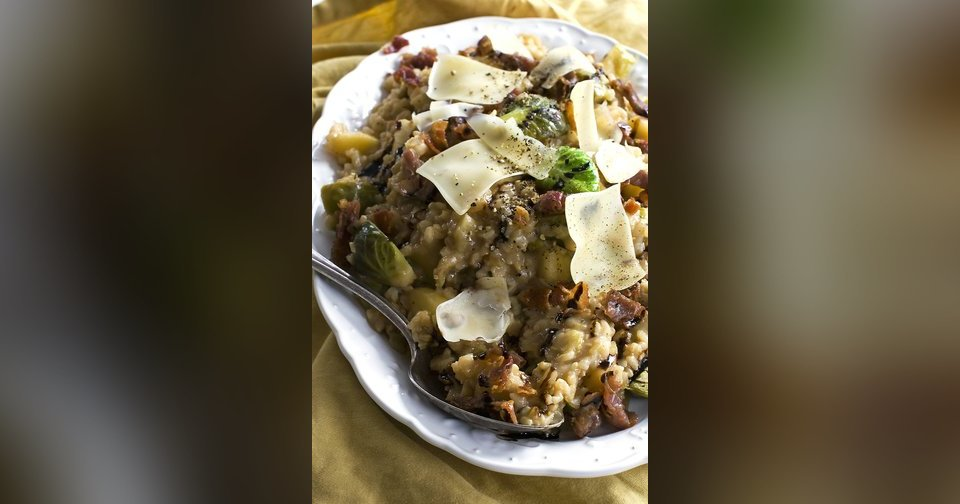 Creamy brown rice risotto two ways: with brussels sprouts and apple.  Matthew Mead - AP