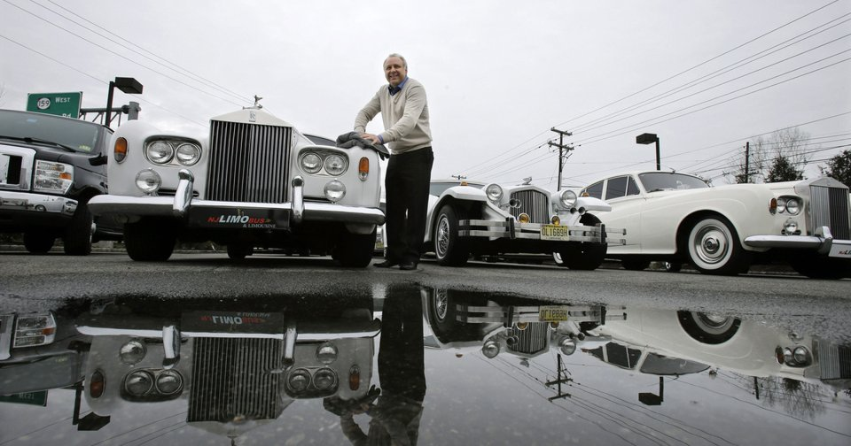 In this Tuesday, Jan. 15, 2013, photo, Joe Brasco, of  New Jersey Limo Bus & Limousine,wipes off a Rolls Royce in Fairfield, N.J. The flu season has created a scramble for New Jersey Limo Bus & Limousine as two of the company\'s seven full-time employees called in sick at the same time, but the Brascos have managed to find substitutes when workers have called in sick. (AP Photo/Mel Evans) ORG XMIT: NJME203