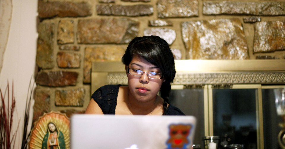 Right: Tracey Medina looks up the phone numbers to law offices in Tulsa.  PHOTOS BY JOHN CLANTON,  TULSA WORLD
