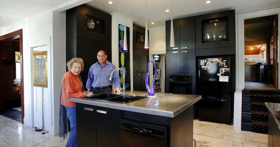 Mary Khoury and her son, Michael, stand in the remodeled and modern kitchen of his 102-year-old home home at 1005 NW 18.  Jim Beckel - THE OKLAHOMAN