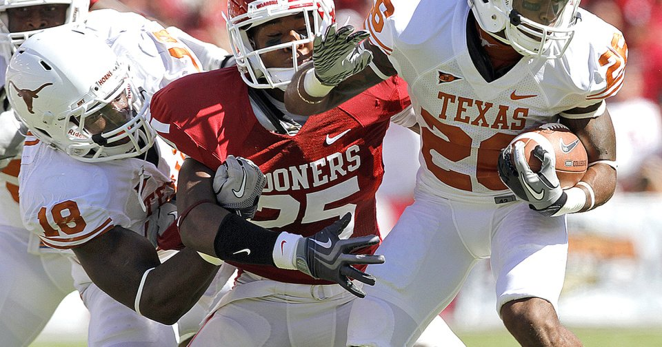 Texas' Emmanuel Acho, left, tries to keep Oklahoma's Corey Nelson, center, from stopping Longhorn D.J. Monroe in the first half of the 2010 Red River Rivalry game. Nelson backs up weak-side linebacker Travis Lewis, but coach Bob Stoops will likely find other ways to get him on the field in the fall. Photo by Chris Landsberger, The Oklahoman