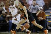 Oklahoma State guard Brittney Martin (22) drives around Texas guard Empress Davenport (1) during the first half of an NCAA college basketball game, Wednesday, Feb. 10, 2016, in Austin, Texas. (AP Photo/Eric Gay)