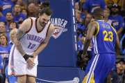 Steven Adams doubles over in pain after being kicked in the groin region by Draymond Green during Game 3 of the Western Conference finals. (Photo by Bryan Terry)
