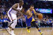 Golden State's Stephen Curry, right, drives to the basket as Oklahoma City's Serge Ibaka defends during an NBA game between the Thunder and  Warriors at the Chesapeake Energy Arena. (Photo by Sarah Phipps, The Oklahoman)