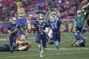 FILE - In this Nov. 29, 2015 file photo, San Jose Marauders youth football players play sports mascots during halftime of an NFL football game between the San Francisco 49ers and the Arizona Cardinals in Santa Clara, Calif. The first concussion study of its kind found youth football players are more likely to return to play less than a day after injury than than those in high school and college. The novel research also found differences in concussion symptoms depending on players' age, offering guidance for parents, doctors and coaches in assessing injured players. (AP Photo/Marcio Jose Sanchez, File)