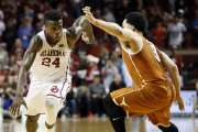 Oklahoma's Buddy Hield (24) drives against Texas' Javan Felix (3) in the second half of a men's college basketball game between the Oklahoma Sooners and the Texas Longhorns at Lloyd Noble Center in Norman, Okla., Monday, Feb. 8, 2016. OU won 63-60. Photo by Nate Billings, The Oklahoman