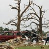 Crushed autos sit amid the rubble as emergency personnel continue search efforts to locate people in that are unaccounted for in the destroyed Rancho Brazos neighborhood of Granbury, Texas, Thursday, May 16, 2013. Ten tornadoes touched down in several small communities in North Texas overnight, leaving at least six people dead, dozens injured and hundreds homeless. Emergency responders were still searching for missing people Thursday afternoon. (AP Photo/The Fort Worth Star-Telegram, Paul Moseley) MAGS OUT; (FORT WORTH WEEKLY, 360 WEST); INTERNET OUT