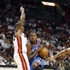 Oklahoma City Thunder player Kevin Durant (35) drives around Miami Heat\'s Quentin Richardson (5) during first half of NBA basketball game in Miami, Tuesday, Nov. 17, 2009. (AP Photo/J Pat Carter) ORG XMIT: AAA106