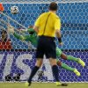United States\' goalkeeper Tim Howard, left, makes a diving save as referee Jonas Eriksson from Sweden watches during the group G World Cup soccer match between Ghana and the United States at the Arena das Dunas in Natal, Brazil, Monday, June 16, 2014. (AP Photo/Julio Cortez)