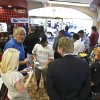 Patrons and members of the media gather at a 4 Sons Food Store where one of the winning tickets in the $579.9 million Powerball jackpot was purchased, Nov. 29, 2012, in Fountain Hills, Ariz.(AP Photo/Ross D. Franklin)