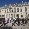 Photo -   Parisians stroll in front of the presidential garden of the Elysee Palace, Paris Sunday, Oct. 28, 2012. Visitors were taking advantage of a new policy inaugurated by President Francois Hollande to open the 18th-century Elysee Palace gardens to the public every last Sunday of the month. In the past, the palace and gardens were only open to the public once a year on France's Heritage Days weekend in September. The gardens are open from noon to 5 p.m. the last Sunday of the month from October to March, and from 1 p.m. to 7 p.m. from April to September. (AP Photo/Michel Euler)