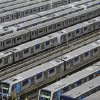 Photo - FILE - In this June 6, 2014, file photo, Metro trains sit parked on the second day of a strike by the operators in Sao Paulo, Brazil. A possible subway strike in Sao Paulo during the tournamente would cripple transportation in South America's biggest city. Authorities are counting on most fans getting to Thursday's match via the subway. Meanwhile, anti-World Cup protests were called for in at least six major cities, including Sao Paulo. (AP Photo/Nelson Antoine,File)