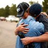 Black Forest Fire evacuee Cindy Miller, left, hugs her husband Ray before he checks on their property with an El Paso County Sheriff\'s escort in Colorado Springs, Colo. on Friday, June 14, 2013. The Millers lost their house in the fire. (AP Photo/The Denver Post, Hyoung Chan) MAGS OUT; TV OUT; INTERNET OUT; NO SALES; NEW YORK POST OUT; NEW YORK DAILY NEWS OUT