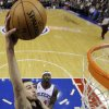 Toronto Raptors\' Jonas Valanciunas, left, of Lithuania, goes up for a dunk against Philadelphia 76ers\' Kwame Brown, center, and Jason Richardson in the first half of an NBA basketball game, Tuesday, Nov. 20, 2012, in Philadelphia. (AP Photo/Matt Slocum)