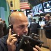 Photo -   Fred DeMarco, a trader with Bay Crest Partners, talks into a headset during early trading on the floor of the New York Stock Exchange on Tuesday, Nov. 20, 2012. (AP Photo/Bebeto Matthews)