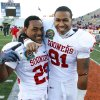 Chris Brown (29) and R. J. Washington (91) celebrate after their 31-27 victory at the Brut Sun Bowl college football game between the University of Oklahoma Sooners (OU) and the Stanford University Cardinal on Thursday, Dec. 31, 2009, in El Paso, Tex. Photo by Steve Sisney, The Oklahoman