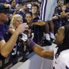 Photo -   Kansas State running back John Hubert (33) celebrates with fans following a 24-19 victory over Oklahoma in an NCAA college football game in Norman, Okla., Saturday, Sept. 22, 2012. (AP Photo/Sue Ogrocki)
