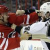Photo - Carolina Hurricanes' Brett Sutter, left, and Pittsburgh Penguins' Joe Vitale, right, fight during the first period of an NHL hockey game in Raleigh, N.C., Monday, Oct. 28, 2013. (AP Photo/Gerry Broome)