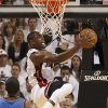 Miami Heat\'s Dwyane Wade goes to the basket against Oklahoma City Thunder\'s Kendrick Perkins (5) and Derek Fisher (37) in the second quarter of Game 3 of the NBA Finals basketball series, Sunday, June 17, 2012, in Miami. (AP Photo/El Nuevo Herald, Pedro Portal) MAGS OUT ORG XMIT: FLMEH203