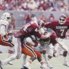 Former Sooner Brian Bosworth lowers the boom on a Miami runner during a 1985 game in Norman. OKLAHOMAN ARCHIVE PHOTO