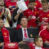 Photo - Manchester United's new manager Louis van Gaal, centre, takes his seat along side assistant manager Ryan Giggs, left, prior to his team's pre-season friendly soccer match,  against Valencia at Old Trafford Stadium, Manchester, England, Tuesday Aug. 12, 2014. (AP Photo/Jon Super)