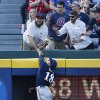 Milwaukee Brewers left fielder Khris Davis (18) can\'t reach a ball hit for a solo-home run by Atlanta Braves first baseman Freddie Freeman (5) in the third inning of a baseball game Monday, May 19, 2014 in Atlanta. (AP Photo/John Bazemore)