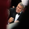 UGeorge Clooney arrives before the 84th Academy Awards on Sunday, Feb. 26, 2012, in the Hollywood section of Los Angeles. (AP Photo/Joel Ryan) ORG XMIT: OSC292