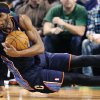Photo - Charlotte Bobcats forward Hakim Warrick grabs a loose ball as he hits the court against the Boston Celtics during the first quarter of an NBA basketball game in Boston, Monday, Jan. 14, 2013. (AP Photo/Charles Krupa)