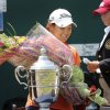 Photo - Diaz-Yi was presented a bouquet of flowers after being awarded the tournament trophy. Lauren Diaz-Yi, of Thousand Oaks, CA, won the U.S. Women's Amateur Public Links Championship, needing only  27 holes to secure the victory over runner-up Doris Chen, at the Jimmie Austin OU Golf Course in Norman on Saturday, June 22, 2013.  Photo  by Jim Beckel, The Oklahoman.