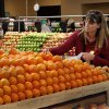 OPEN / OPENING: Shopper Donna McLaughlin of Edmond selects oranges in the produce section of the store. Sunflower Farmers Market on Second Street in Edmond opened for business Wednesday, April 4, 2012. Photo by Jim Beckel, The Oklahoman