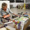 Billie Slavin, first-grade teacher at Arbor Grove Elementary School in the Putnam City School District, picks out school supplies at Feed the Children\'s new Teachers Store. Photo by Paul Hellstern, The Oklahoman PAUL HELLSTERN