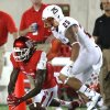 Photo - Houston wide receiver Deontay Greenberry (3) drops a pass with UTSA safety Mauricio Sanchez (25) defending during the second quarter of an NCAA college football game Friday, Aug. 29, 2014, in Houston. (AP Photo/Houston Chronicle, Brett Coomer) MANDATORY CREDIT