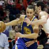 Golden State Warriors guard Stephen Curry, left, drives to the basket as Chicago Bulls guard Kirk Hinrich defends during the first half of an NBA basketball game in Chicago on Friday, Jan. 25, 2013. (AP Photo/Nam Y. Huh)