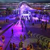 Photo - People walk around a stage during the Electric Daisy Carnival, Friday, June 20, 2014, in Las Vegas. People from around the world come to the event to listen to electronic dance music and experience the lights, art installations and carnival rides. (AP Photo/John Locher)
