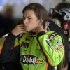 Photo - Danica Patrick removes her earplugs after a turn driving during practice for the NASCAR Daytona 500 Sprint Cup Series auto race at Daytona International Speedway, Saturday, Feb. 16, 2013, in Daytona Beach, Fla. (AP Photo/Phelan M. Ebenhack)