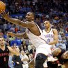 Oklahoma City\'s Kendrick Perkins is pulled away from a rebound by Toronto\'s Amir Johnson during the second half of their NBA basketball game at the OKC Arena in downtown Oklahoma City on Sunday, March 20, 2011. The Raptors beat the Thunder 95-93. Photo by John Clanton, The Oklahoman