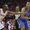 Oklahoma City\'s Kevin Martin (23) looks to pass the ball as Houston\'s James Anderson (5) defends during Game 6 in the first round of the NBA playoffs between the Oklahoma City Thunder and the Houston Rockets at the Toyota Center in Houston, Texas, Friday, May 3, 2013. Photo by Bryan Terry, The Oklahoman