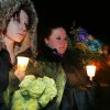 Photo - DEATHS / MURDERS / KIDS / MOTHER / SON / DAUGHTERS / FAMILY / CHILDREN / HOMICIDES / ELIZABETH PLACE APARTMENT HOMES / EL RENO: Kayla James and Nicole Williams take part in a candlelight vigil in El Reno , Okla. January  15, 2009.  BY STEVE GOOCH, THE  OKLAHOMAN.  ORG XMIT: KOD
