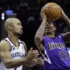 Sacramento Kings\' Isaiah Thomas (22) shoots over Memphis Grizzlies\' Jerryd Bayless, left, during the first half of an NBA basketball game in Memphis, Tenn., Friday, Jan. 18, 2013. (AP Photo/Danny Johnston)