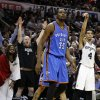 Oklahoma City\'s Kevin Durant (35) and San Antonio\'s Danny Green (4) watch a Green 3-point shot go in as fans celebrate during Game 5 of the Western Conference Finals in the NBA playoffs between the Oklahoma City Thunder and the San Antonio Spurs at the AT&T Center in San Antonio, Thursday, May 29, 2014. Photo by Sarah Phipps, The Oklahoman
